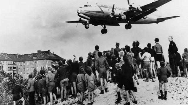 PHOTO: American and British transportation planes supply food to Berlin's Western sector isolated by the Soviet's blockade.