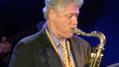 PHOTO: President Bill Clinton plays the sax at 'A Family Celebration 2001' at the Regent Beverly Wilshire Hotel in Beverly Hills, Cali. in this April 1, 2001 file photo.