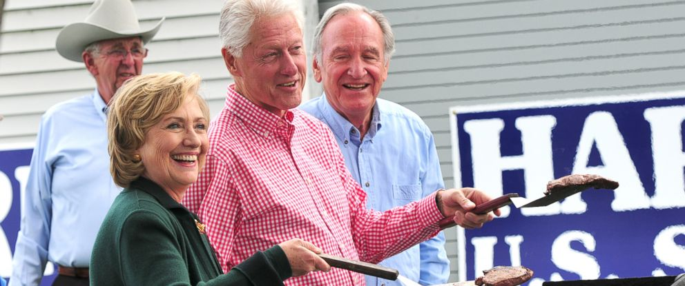 PHOTO: Former President Bill Clinton and his wife, former Secretary of State Hillary Rodham Clinton flip steaks at the 37th Harkin Steak Fry, Sept. 14, 2014 in Indianola, Iowa.