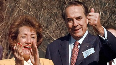 PHOTO: Republican presidential candidate Bob Dole, and his wife Elizabeth, react to the results of the New York primary to a crowd of supporters in Tampa, Florida in this March 8, 1996 file photo.