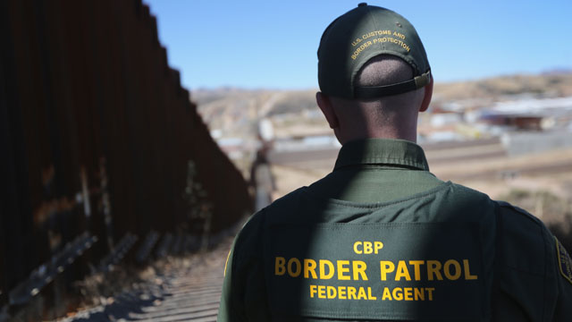 PHOTO: A U.S. Border Patrol agent looks along a section of the recently-constructed fence at the U.S.-Mexico border on February 26, 2013 in Nogales, Arizona.