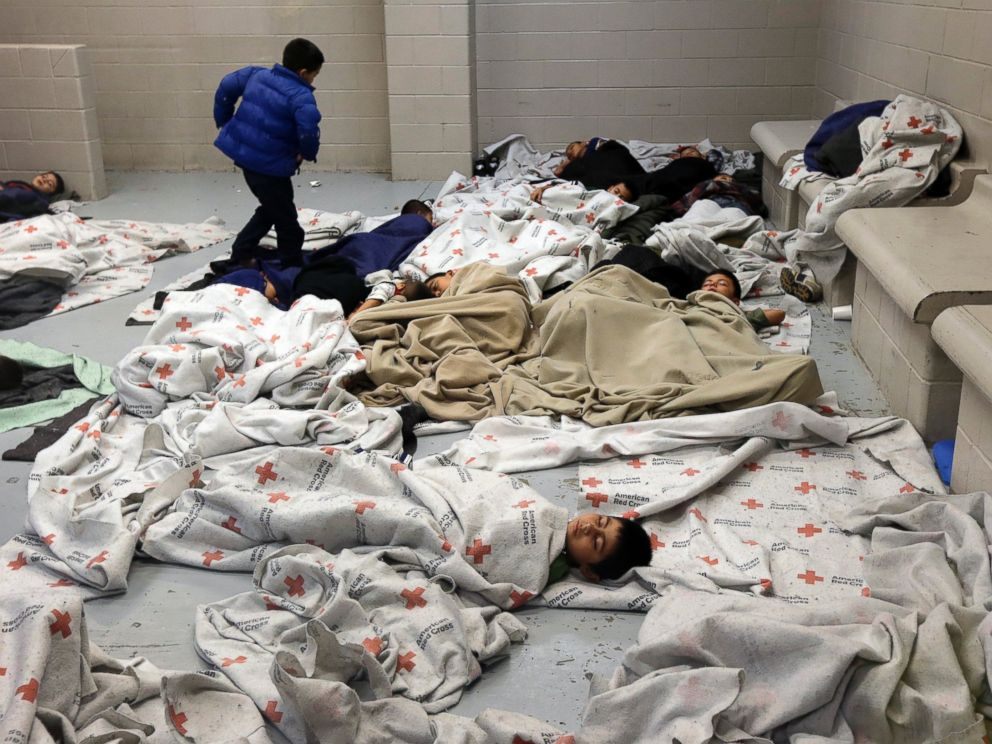 PHOTO: Detainees sleep in a holding cell at a U.S. Customs and Border Protection processing facility, on June 18, 2014, in Brownsville, Texas.