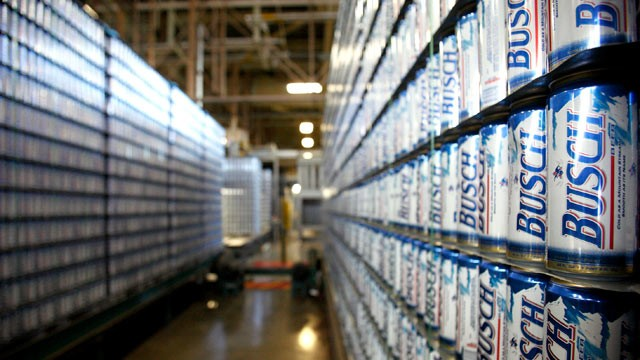 PHOTO: Stacks of empty Busch beer cans stand in the empty can receiving area of the Anheuser-Busch InBev NV Fairfield brewery in Fairfield, Calif.