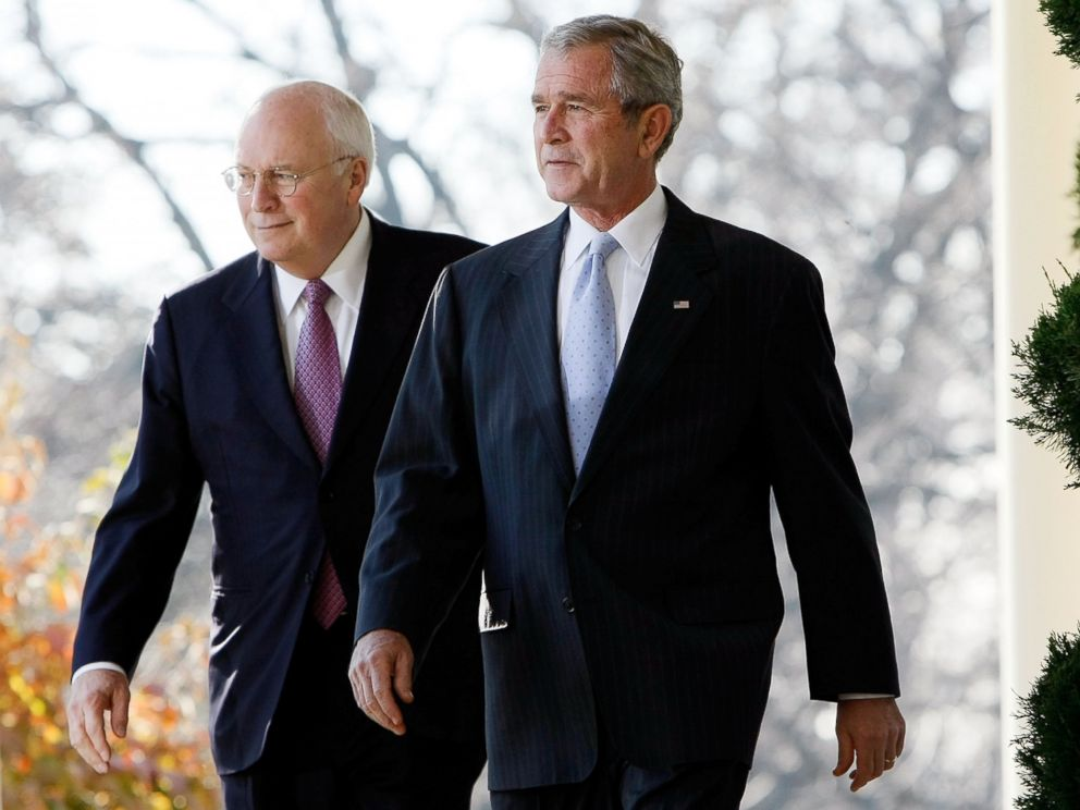 PHOTO: George W. Bush and Dick Cheney talk as they make their way to the Rose Garden at the White House Dec. 14, 2007 in Washington