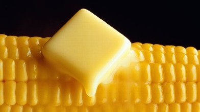 PHOTO: Knob of butter melting over corn on the cob.