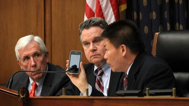 PHOTO: U.S. Rep. Chris Smith (R-NJ), 2nd left, Rep. Frank Wolf (R-VA), left, and Chinese dissident and president of ChinaAid Bob Fu, right, listen to Chinese human rights lawyer Chen Guangcheng on the phone during a hearing before the Congressional-Execut