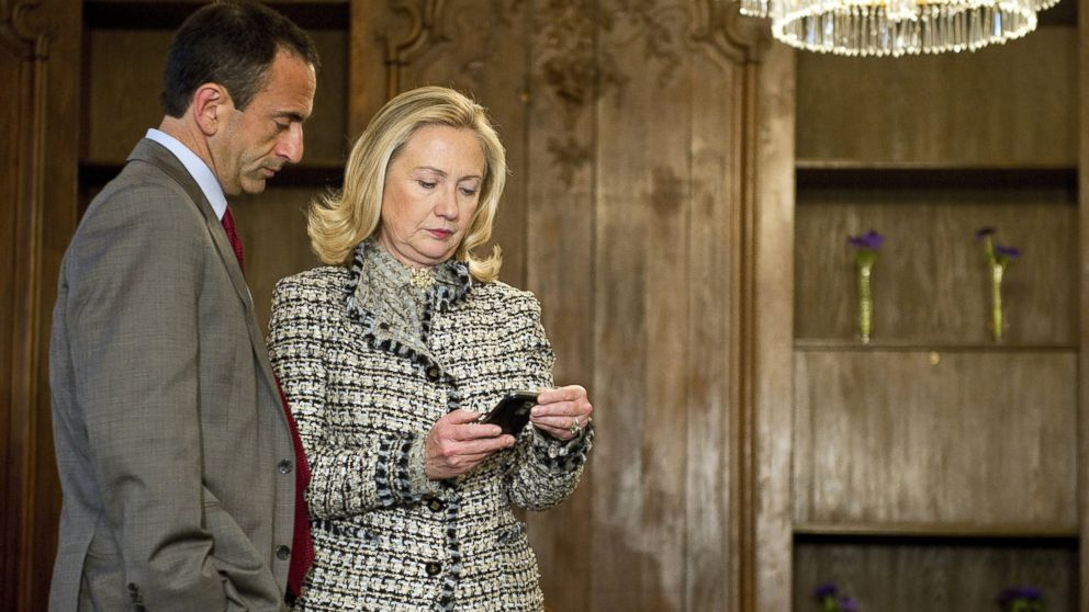 PHOTO: Secretary of State Hillary Clinton looks at a phone message with Assistant Secretary of State for European Affairs Philip Gordon in Munich, Germany, Feb. 4, 2012.