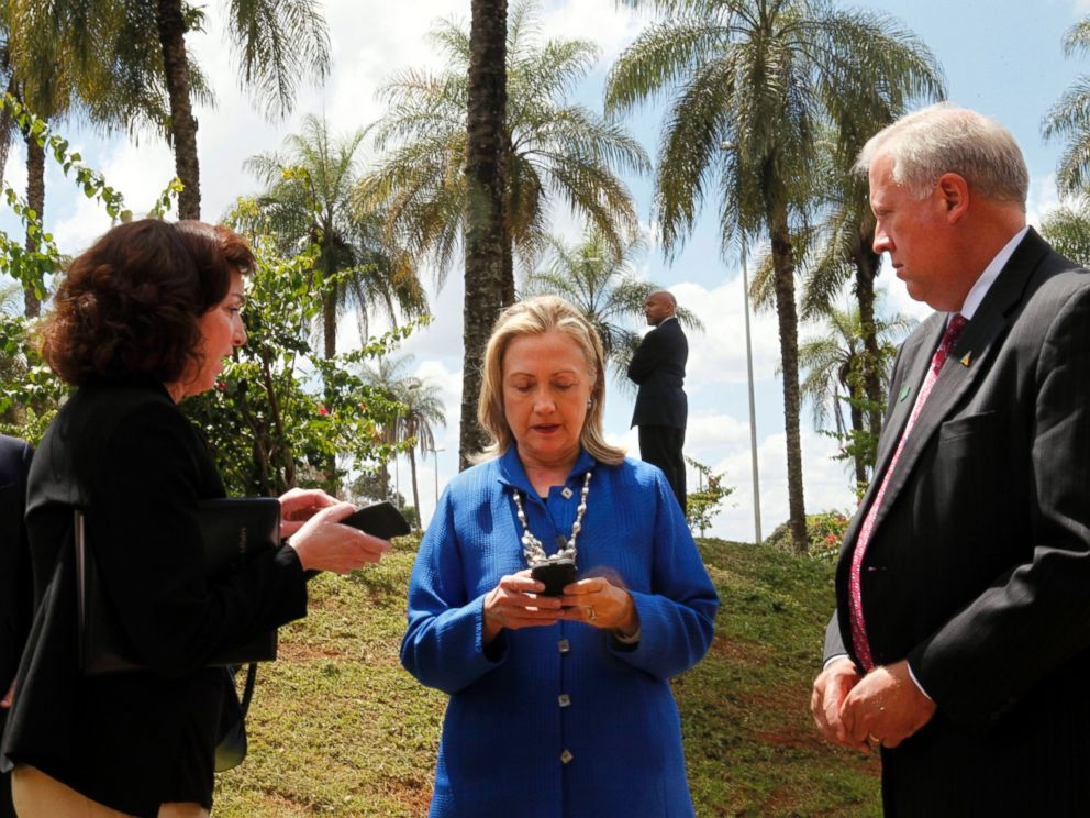 PHOTO: Secretary of State Hillary Rodham Clinton writes on her cell phone with Roberta S. Jacobson, left, and Thomas Shannon in Brasilia, Brazil, April 17, 2012.