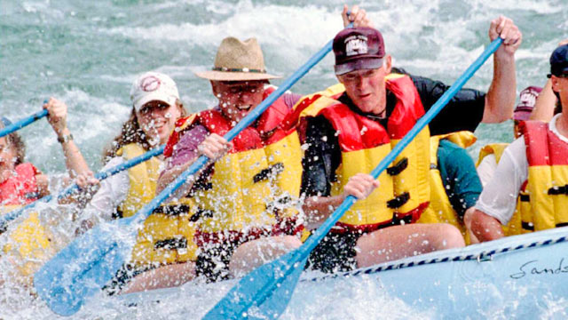 PHOTO: President Bill Clinton (C) and daughter Chelsea (L) paddle while rafting down the Snake River on Aug. 22, 1995 in Bridger-Teton National Forest, Wyo.