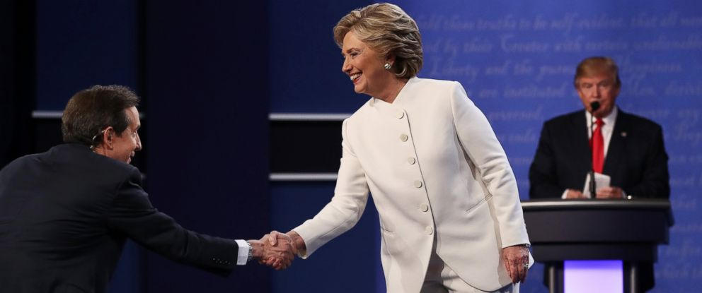 PHOTO: Hillary Clinton shakes hands with Fox News anchor and moderator Chris Wallace as Donald Trump looks on after the third U.S. presidential debate at the Thomas & Mack Center, Oct. 19, 2016 in Las Vegas.