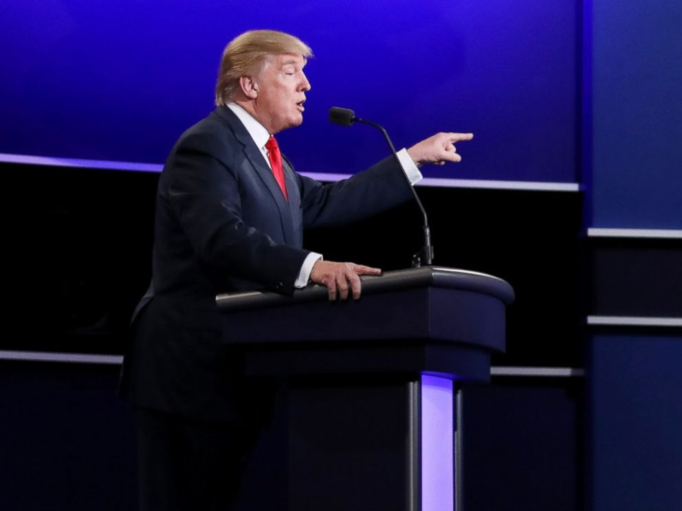 PHOTO: Republican presidential nominee Donald Trump speaks as Democratic presidential nominee Hillary Clinton looks on during the third U.S. presidential debate at the Thomas & Mack Center in Las Vegas, Oct. 19, 2016.