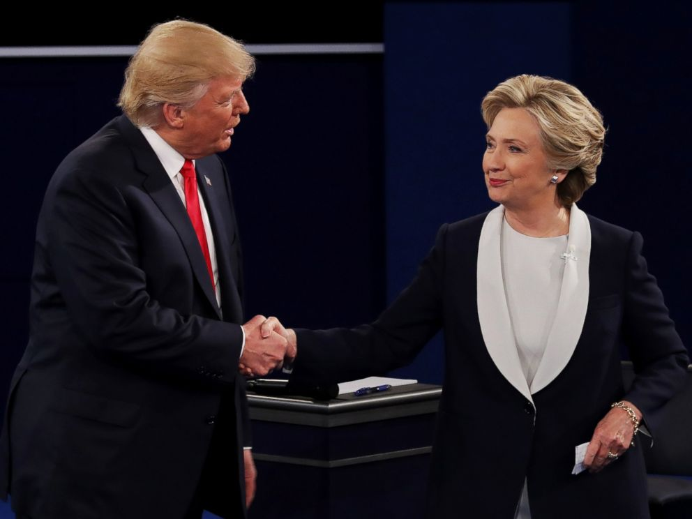 PHOTO: Donald Trump shakes hands with Hillary Clinton during the town hall debate at Washington University on Oct. 9, 2016 in St Louis, Missouri.
