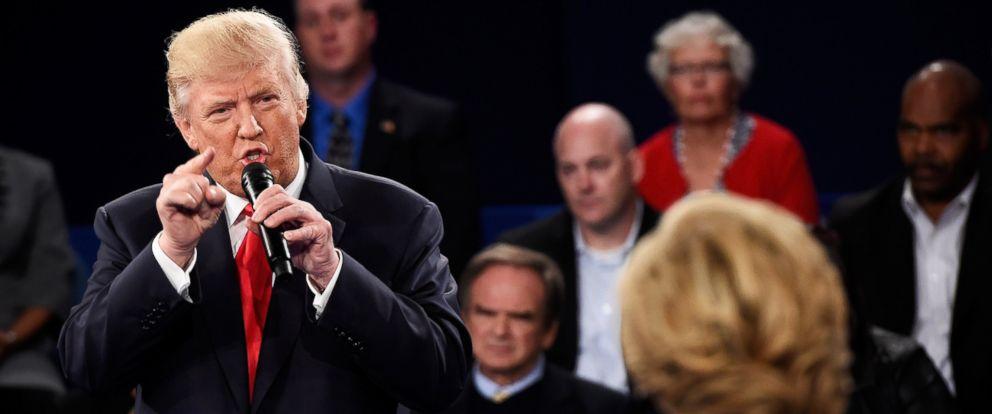 PHOTO: Donald Trump speaks as Hillary Clinton listens during the town hall debate at Washington University on Oct. 9, 2016 in St Louis, Missouri.