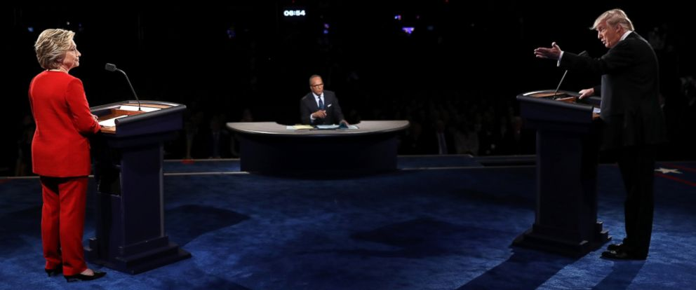 PHOTO: Donald Trump speaks as Hillary Clinton and Moderator Lester Holt listen during the Presidential Debate at Hofstra University on Sept. 26, 2016 in Hempstead, New York.