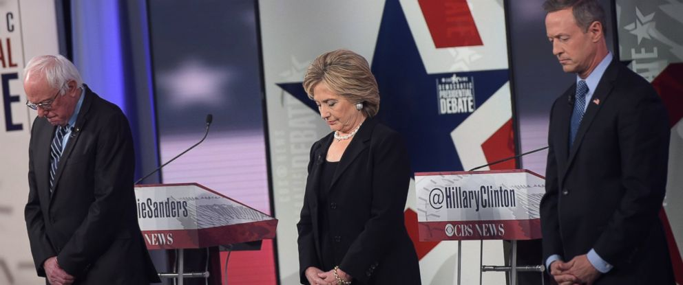 PHOTO: Bernie Sanders, Hillary Clinton, and Martin OMalley pause for a moment of silence, for the victims of the Paris terrorists attacks, before the start of the second Democratic presidential primary debate on Nov. 14, 2015 in Des Moines, Iowa.