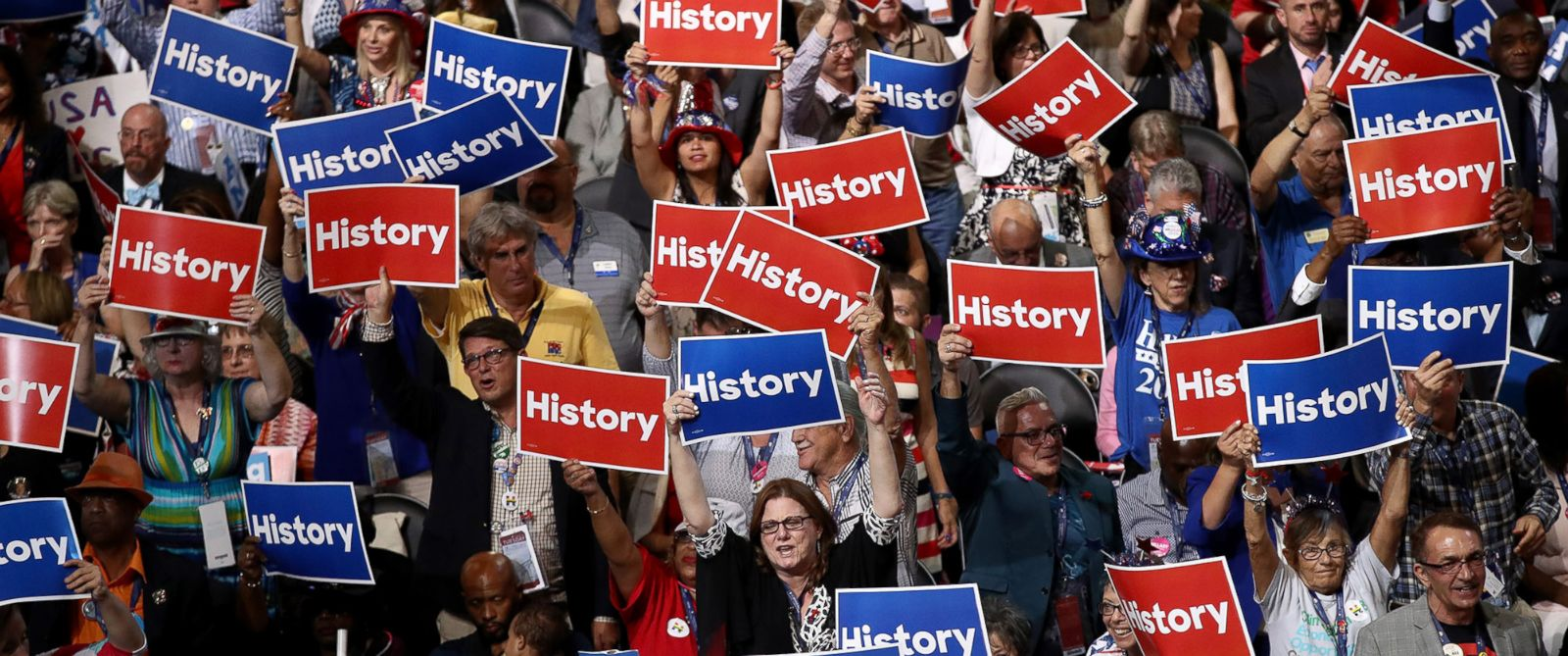 PHOTO: Delegates hold up signs and cheer on the second day of the Democratic National Convention at the Wells Fargo Center, July 26, 2016 in Philadelphia.
