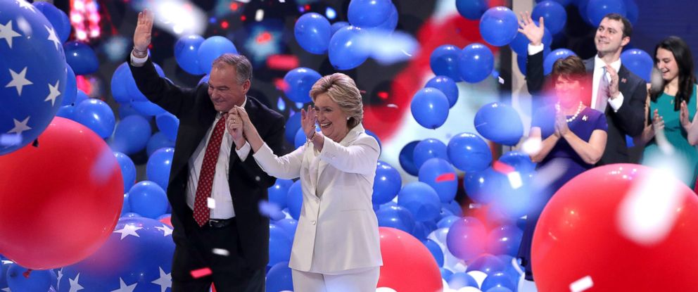 PHOTO: Democratic presidential nominee Hillary Clinton and vice presidential candidate Tim Kaine acknowledge the crowd at the end on the fourth day of the Democratic National Convention as balloons fall, July 28, 2016 in Philadelphia.