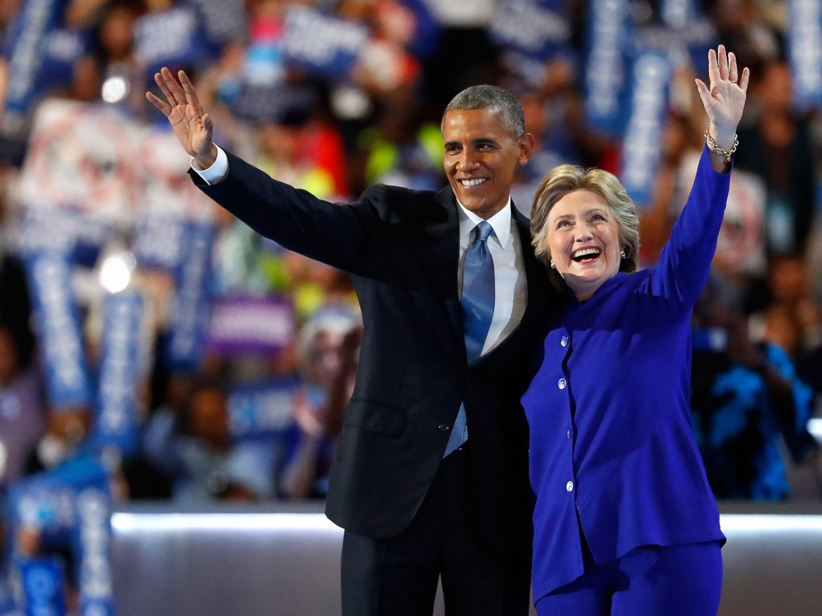 PHOTO: President Barack Obama and Democratic presidential candidate Hillary Clinton wave to the crowd on the third day of the Democratic National Convention, July 27, 2016 in Philadelphia.