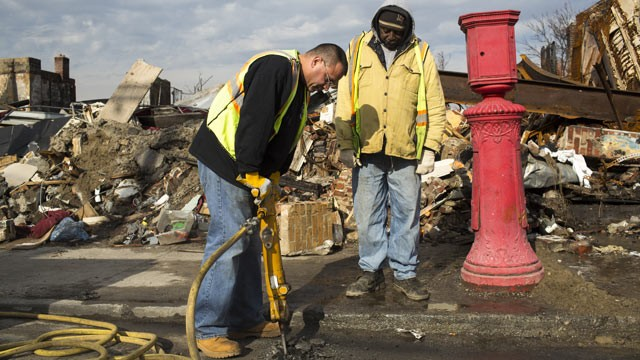 PHOTO: A jack-hammer operator from New Yorks Department of Environmental Protection, DEP, removes asphalt from a street, Jan. 17, 2013, to fix a leaking water pipe damaged during Hurricane Sandy in the Rockaways in the Queens borough of New York.