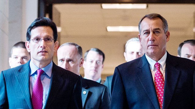 PHOTO: House Majority Leader Eric Cantor, R-Va., left, and Speaker of the House John Boehner, R-Ohio, make their way to their news conference, Dec. 21, 2012.