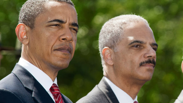 PHOTO: President Barack Obama and Attorney General Eric Holder sit at the start of the 29th annual National Peace Officers Memorial Service, May 15,  2010, at the White House in Washington.