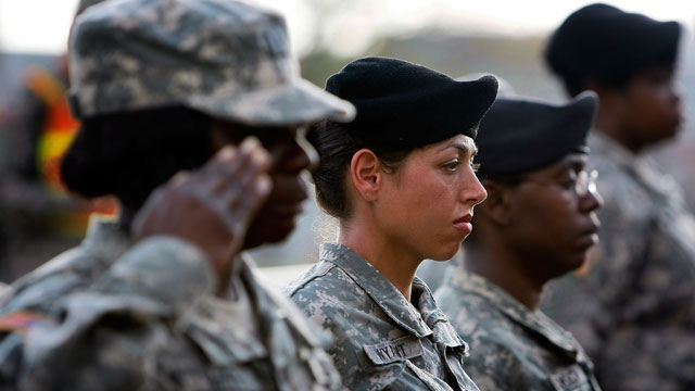 PHOTO: U.S. Army soldiers stand together as they