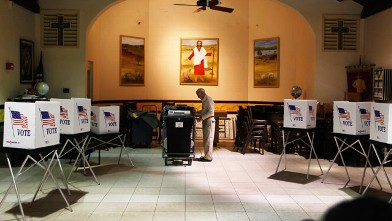 PHOTO: Ray Roy sets up a polling station in preparation for voters on primary day January 31, 2012 in Tampa, Florida.