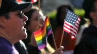 PHOTO: An opponent of Prop 8 holds an American flag and gay pride flag during a demonstration outside of the Ninth Circuit Court of Appeals in this Dec. 6, 2010 file photo in San Francisco, Cali.