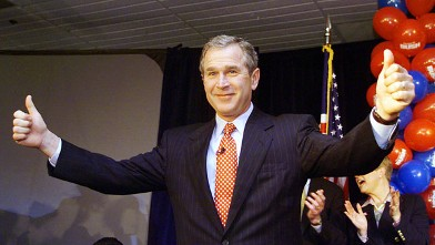 PHOTO: US Republican Presidential candidate Texas Governor George W. Bush appears in front of supporters at a downtown hotel ballroom.