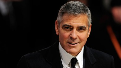 PHOTO: Actor, director, producer and screenwriter George Clooney poses on the red carpet at the Royal Opera House in London, Feb. 12, 2012.