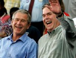 PHOTO: George W. Bush and his brother Jeb Bush smile while greeting supporters during a campaign rally at Progress Energy Park, Oct. 19, 2004 in St. Petersburg, Fla.