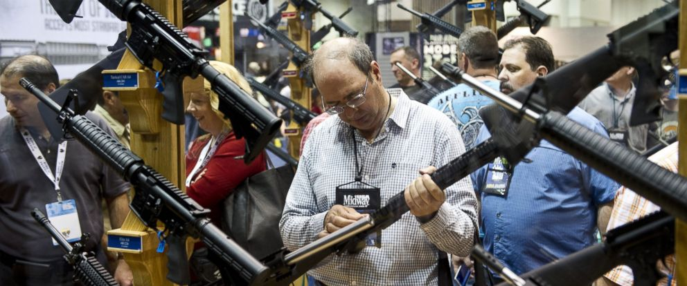 PHOTO: A convention goer examines weapons in the exhibit hall at the143rd NRA Annual Meetings and Exhibits at the Indiana Convention Center in Indianapolis, Indiana, on April 26, 2014.