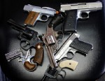 PHOTO: Pistols that were turned in during a gun buy back program in Dallas, Texas.