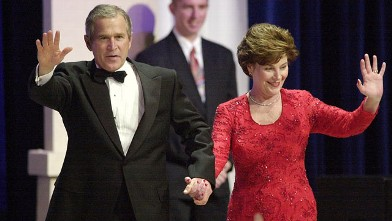 PHOTO: President George W. Bush and wife Laura wave to supporters while attending the Florida State Inaugural Ball Jan. 20, 2001 at the Pension Building in Washington D.C.