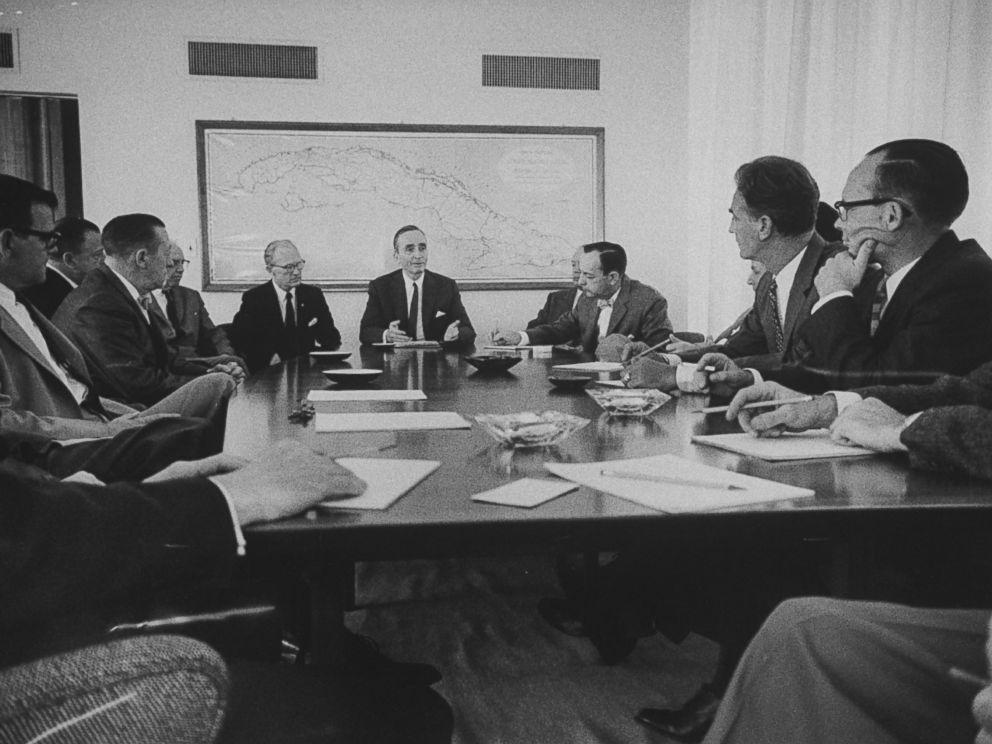 PHOTO: Ambassador Philip W. Bonsal meets with his staff at the U.S. Embassy in Havana, Cuba in 1960.