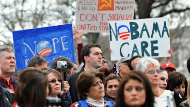 Participants display placards during a demonstration in Washington, D.C., March 16, 2010, in opposition to the health care reform bill.