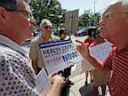 PHOTO: Opponents argue over heath insurance reform outside town hall