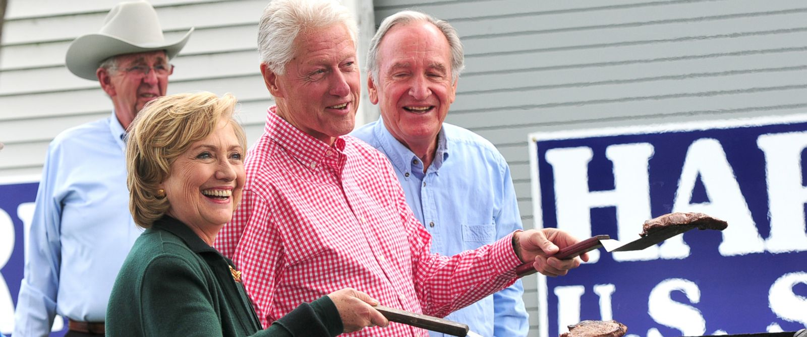 PHOTO: Former President Bill Clinton and his wife, former Secretary of State Hillary Rodham Clinton and Senator Tom Harkin flip steaks at the 37th Harkin Steak Fry, Sept. 14, 2014 in Indianola, Iowa.