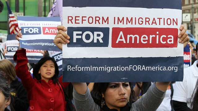 PHOTO:A slew of controversial state laws to go into effect Jan. 1. Pictured, protesters carry signs during an immigration reform demonstration March 24, 2010 in San Francisco, California with more than 2,000 demonstrators in attendance.