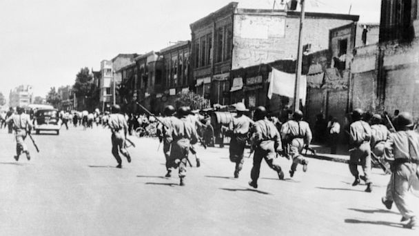 PHOTO: Persian soldiers chase rioters during civil unrest in Tehran, Aug. 1953.
