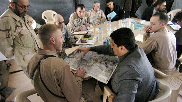 PHOTO: U.S. Marine Capt. Jason Brezler, of the 4th Civil Affairs Group, (2nd L) meets with engineers and contractors of Fallujah, Iraq, to discuss US-funding for a road paving project in the city, Fallujah, Iraq, Nov. 22, 2006.