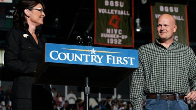 PHOTO: Joe Wurzelbacher looks on as Sarah Palin speaks October 29, 2008 at Bowling Green University in Bowling Green, Ohio. Joe Wurzelbacher, also known as &quot;Joe the plumber&quot; of Holland, Ohio, campaigned with Palin for the first time at the event.
