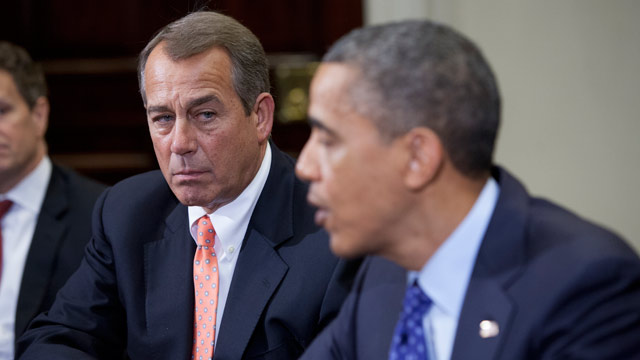 PHOTO: Speaker John Boehner, R-OH., listens to President Barack Obama speak before a budget meeting at the White House with other cabinet members on Nov. 16, 2012 in Washington, D.C.