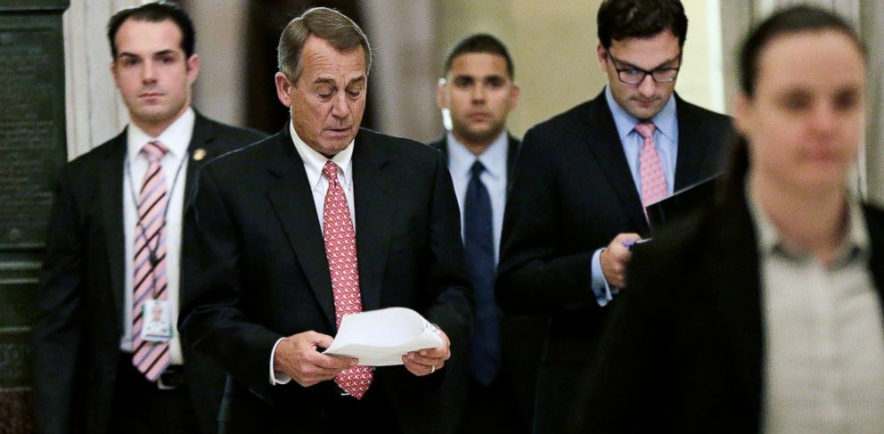 PHOTO: House Speaker John Boehner, R-Ohio, second from left, walks to the House Chamber to vote on the recently announced bipartisan budget agreement, Dec. 12, 2013, in Washington.