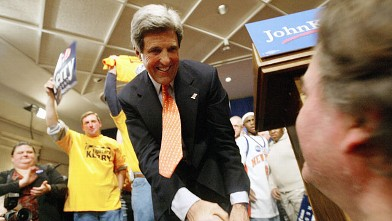 PHOTO: Democratic candidate for U.S. President Massachusetts Senator John Kerry Celebrates after winning the Iowa caucus vote.