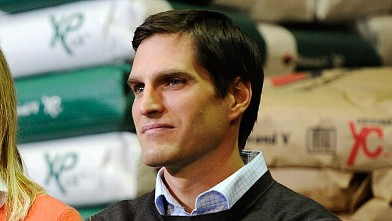 PHOTO: Josh Romney son of Republican Presidential hopeful and former Massachusetts Gov. Mitt Romney, looks on during a town hall meeting, December 9, 2011 in Cedar Rapids, Iowa.