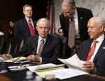 "PHOTO: Sen. Chuck Grassley, R-IA, leans down to talk to Sen. Jeff Sessions, R-AL, 2nd right, and Sen. Orrin Hatch, R-UT, right, prior to a hearing before the Senate Judiciary Committee, April 19, 2013, on ""Comprehensive Immigration Reform Legislation"" on"