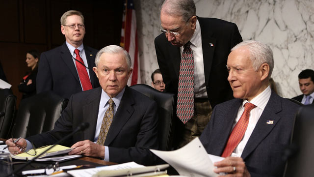 PHOTO: Sen. Chuck Grassley, R-IA, leans down to talk to Sen. Jeff Sessions, R-AL, 2nd right, and Sen. Orrin Hatch, R-UT, right, prior to a hearing before the Senate Judiciary Committee, April 19, 20