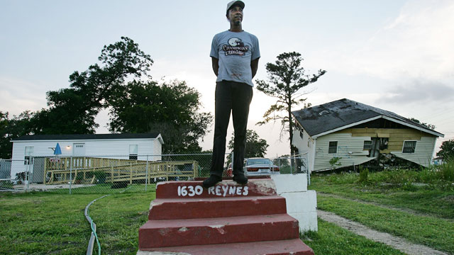 PHOTO: Warren Schexnader stands on the steps of his old home in front of another destroyed home, right, and the FEMA