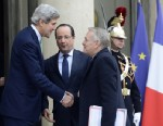 PHOTO: US Secretary of State John Kerry (L) shakes hands with French Prime Minister Jean-Marc Ayrault (R) on February 27, 2013 as he leaves the presidential Elysee palace in Paris after meeting with French President Francois Hollande (C).
